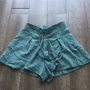 LUSH lace up shorts green size small